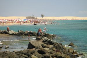 People fishing at the beach